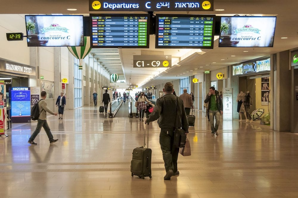 Passenger looking at the departure timetable in the Ben Gurion International Airport stock image. TEL AVIV, ISRAEL,