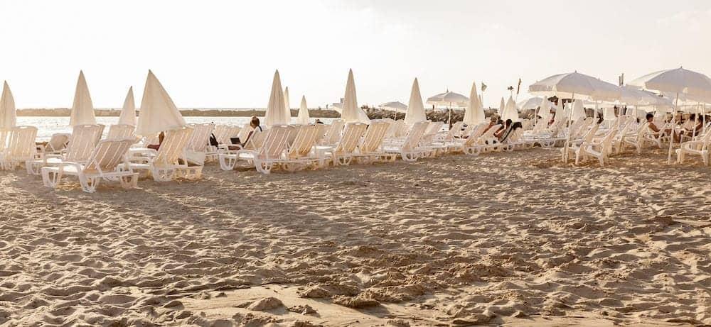 Tel Aviv, Israel - People relaxing on the beach in Tel Aviv.
