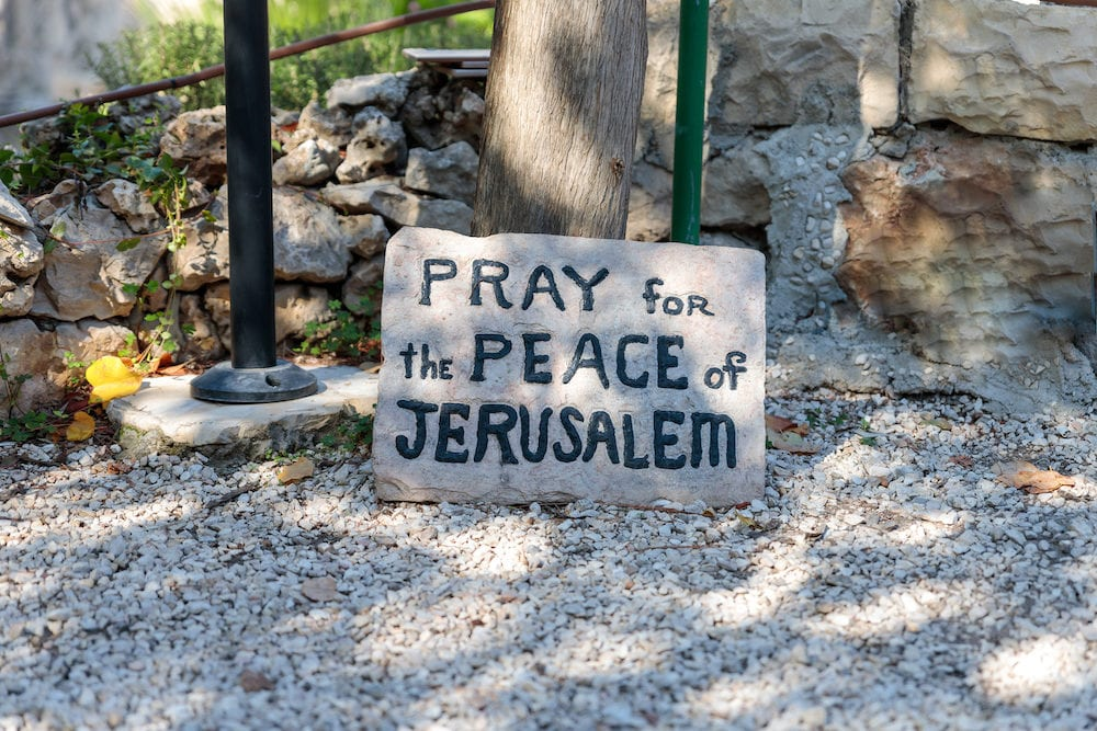 Jerusalem, Israel, : Plate with the inscription - Pray for the peace of Jerusalem - in The Garden Tomb Jerusalem located in East Jerusalem, Israel
