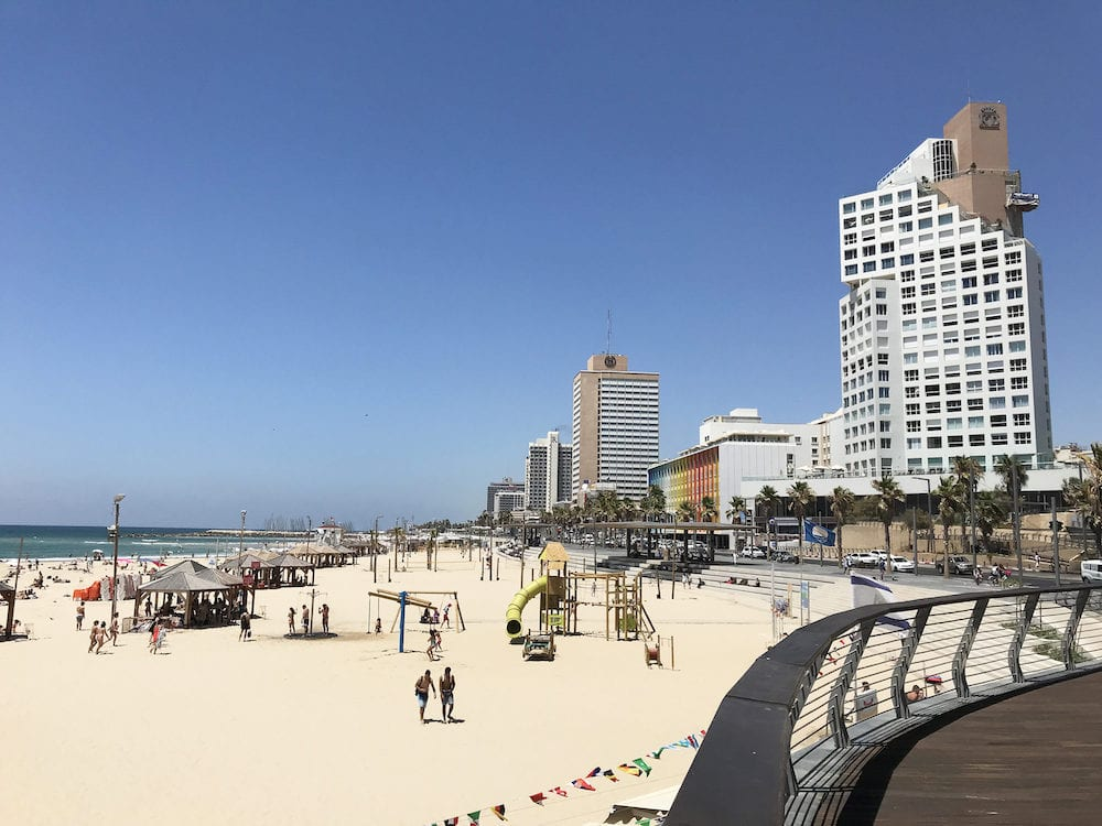 TEL AVIV, ISRAEL - The beach along the Tel Aviv Promenade or Tayelet in Hebrew running along the Mediterranean seashore.