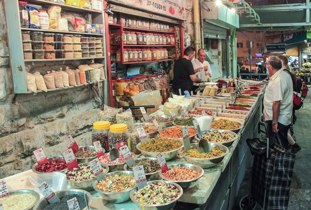 Jerusalem, Israel, : The seller in the open shop weighs the spice buyer in the Mahane Yehuda market in Jerusalem, Israel