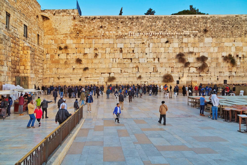 JERUSALEM, ISRAEL - Jewish hasidic pray a the Western Wall, Wailing Wall the Place of Weeping is an ancient limestone wall in the Old City of Jerusalem.