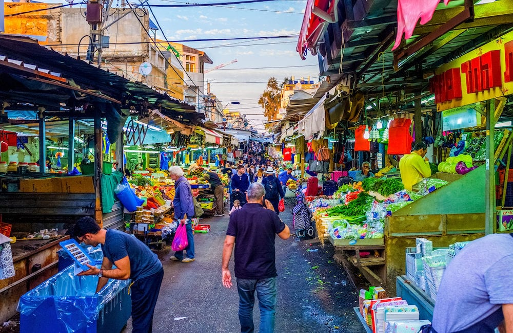 TEL AVIV ISRAEL - : The noisy and crowded Carmel Market in Yemenite quarter is one of the city landmarks offering fresh vegetables fruits and local food in Tel Aviv.