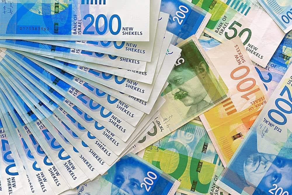 Israeli money stack of the new Israeli money bills (banknotes) of 50, 100 and 200 shekel. New Israeli Shekel series C.