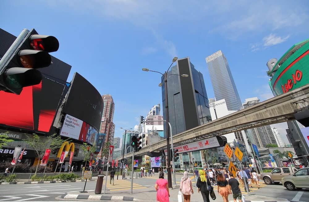 KUALA LUMPUR MALAYSIA -\Unidentified people visit Bukit Bintang shopping street in Kuala Lumpur Malaysia
