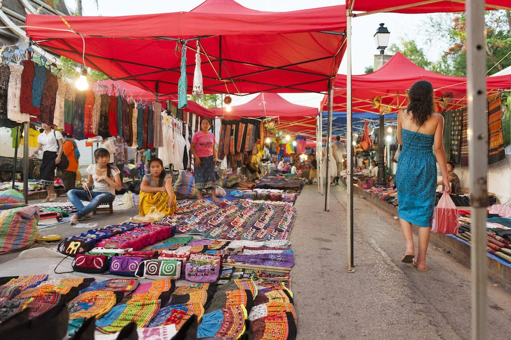 Luang Prabang Laos - Luang Prabang Night Market popular tourist venue for souvenirs and handicraft products located on main street in central area in front of the Royal Palace Museum in the UNESCO World Heritage town of Lao PDR.