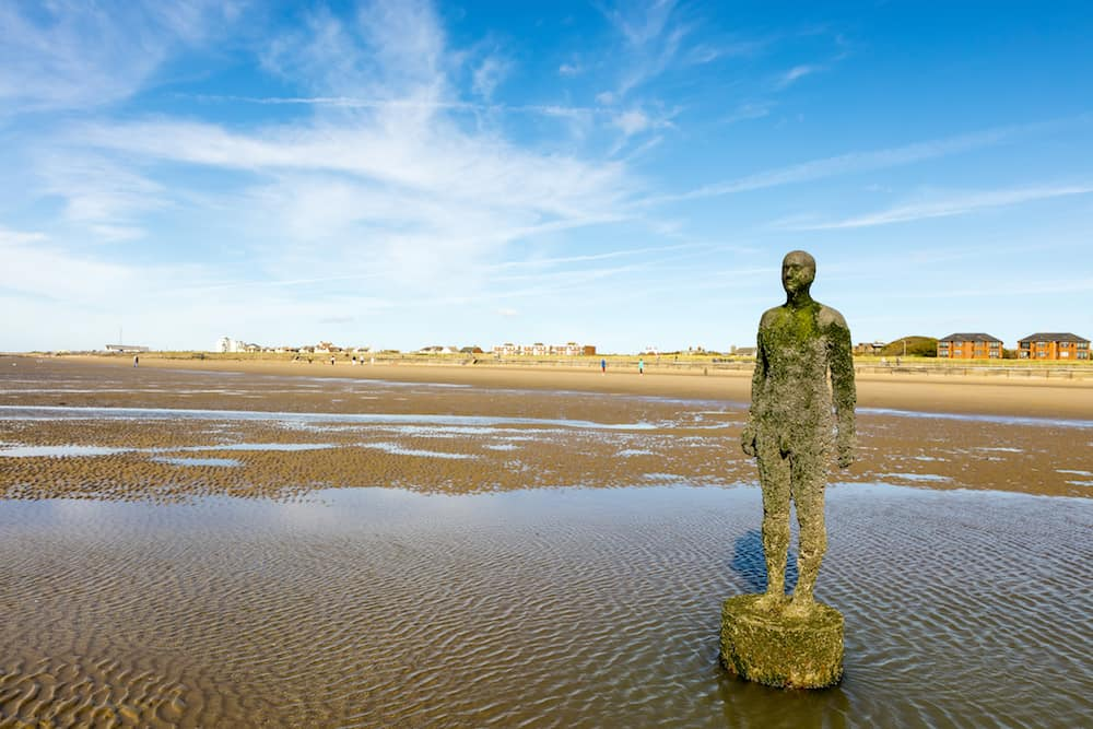 CROSBY BEACH, ENGLAND - Detail of Another Place by Antony Gormley consists of 100 cast-iron, life-size figures spread out along three kilometres of the foreshore near Liverpool on