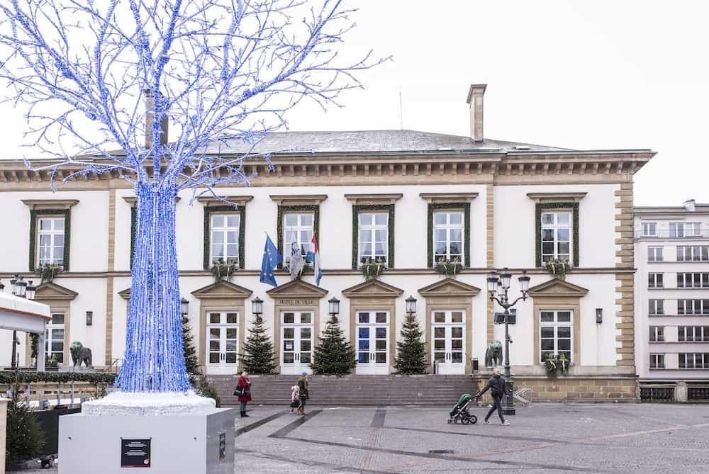 Grand Duchy of Luxembourg Luxembourg- Pedestrians with children walk past Hotel de Ville