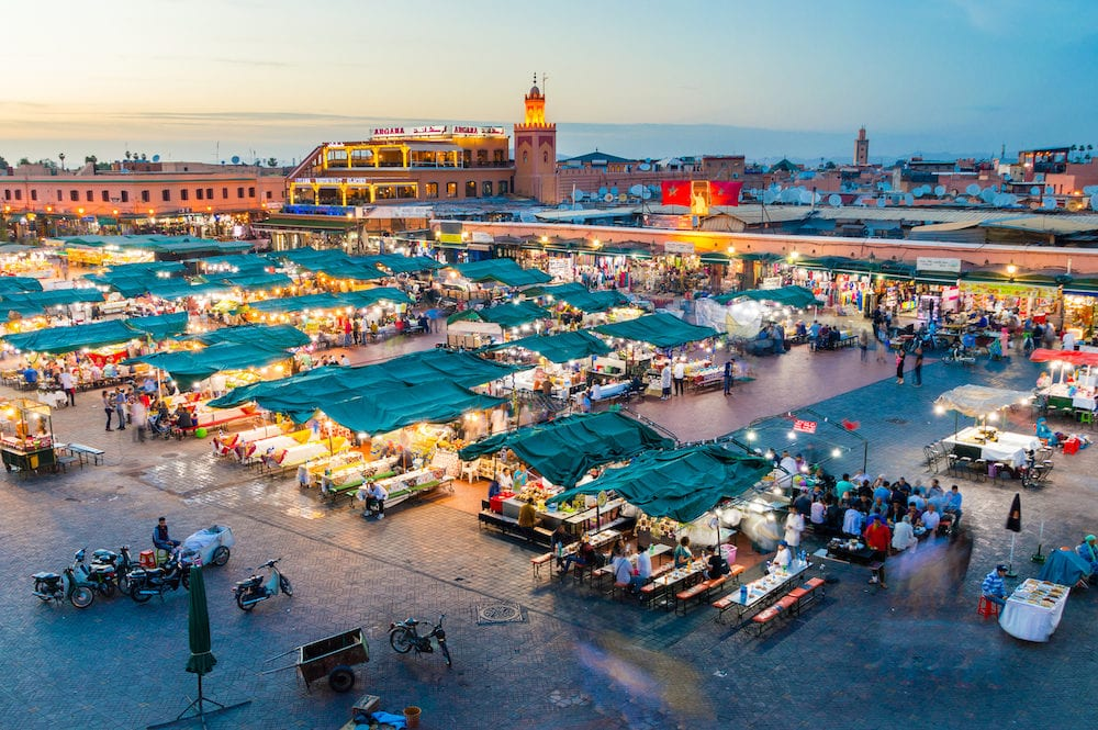 Marrakech, Morocco - Jemaa el-Fnaa square and market place at dusk.