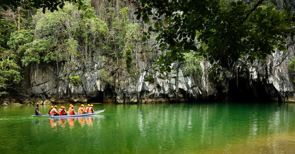 PALAWAN PHILIPPINES Boats at cave entrance of Puerto Princesa subterranean underground river - One of the 7 New Wonders of Nature