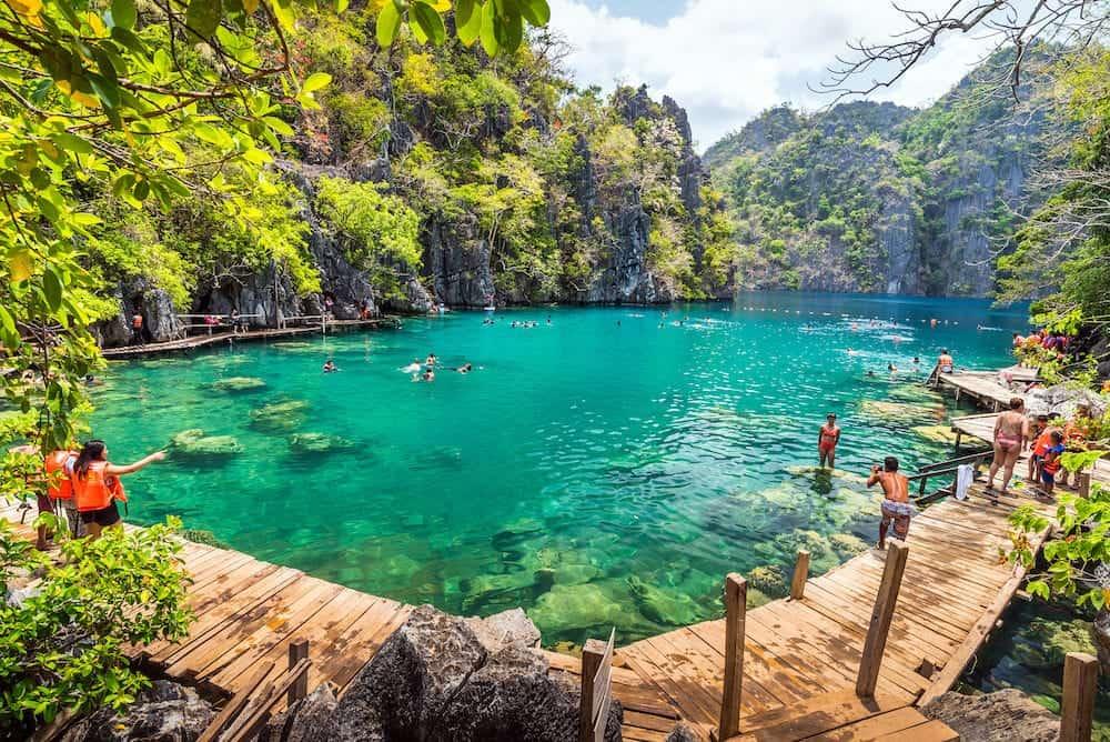 Palawan, Philippines - People tourists swimming at Kayangan Lake in Coron Island, Palawan, The Philippines.