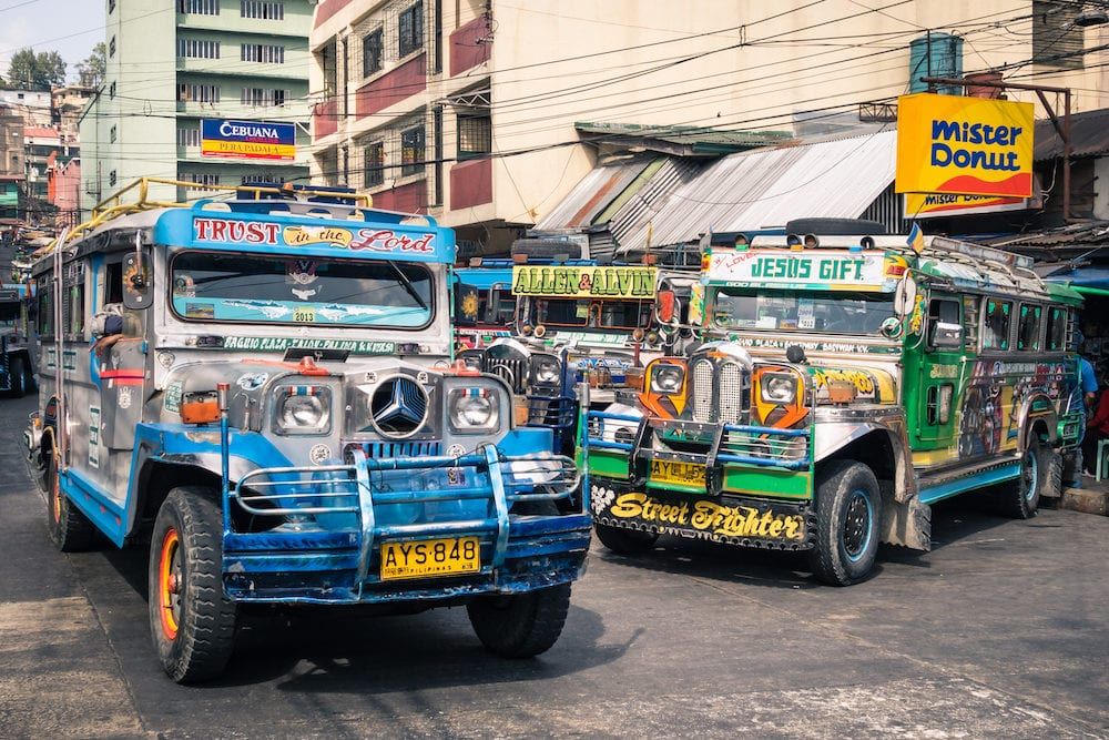 BAGUIO PHILIPPINES - colorful jeepneys at the bus station of the city of Baguio. Inspired from US military jeeps those are the cheapest and kitschest transportation in the country.