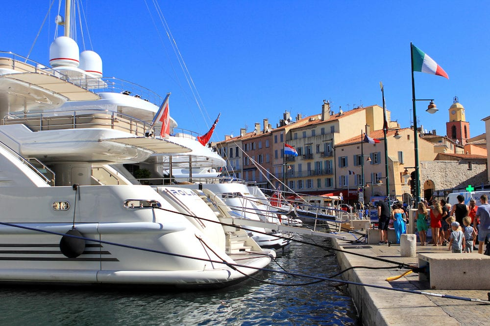 SAINT-TROPEZ PROVENCE FRANCE - : Tourists in the old port of St Tropez admiring the expensive luxury yachts
