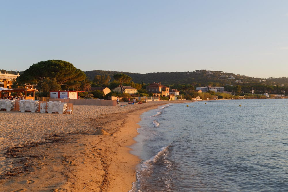 sandy beach and surf line on Mediterranean coast, summer evening in Saint-tropez, France