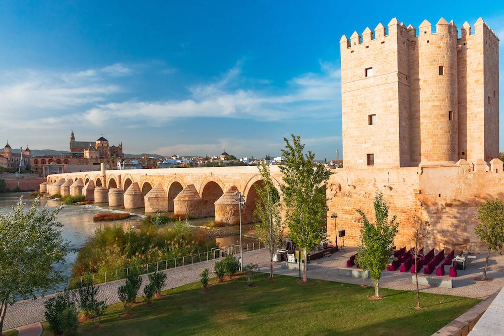 Great Mosque Mezquita - Catedral de Cordoba, Roman bridge across Guadalquivir river, old mill and Torre de Calahorra in the morning, Cordoba, Andalusia, Spain