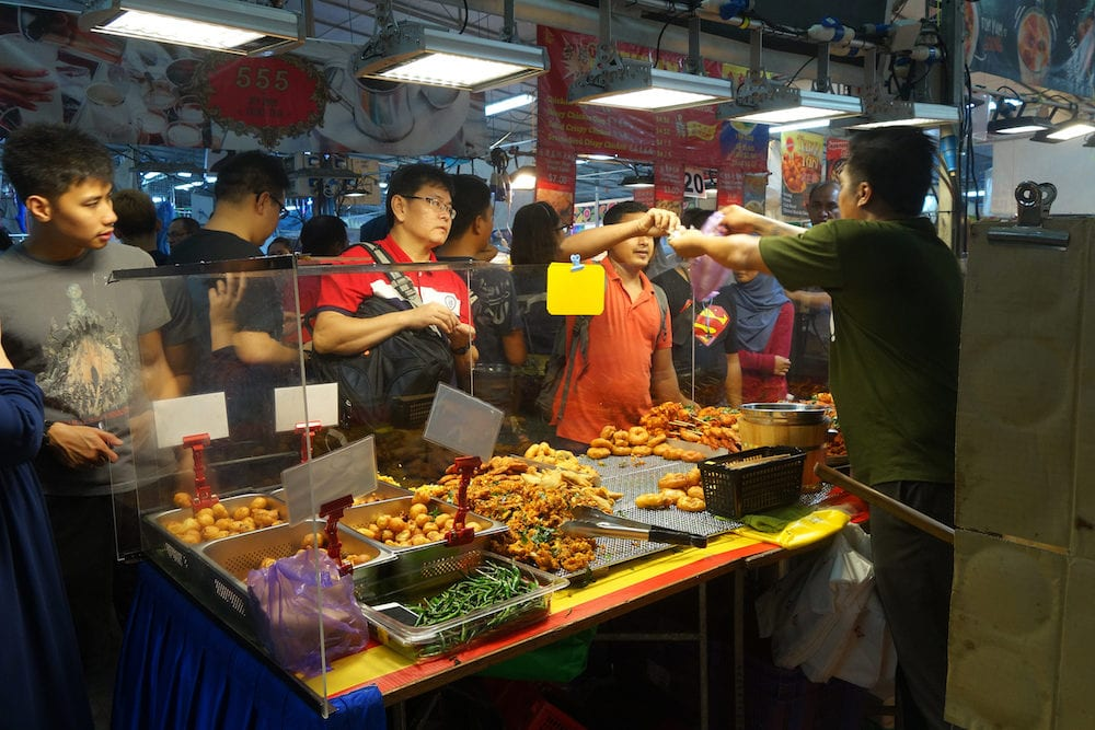 SINGAPORE- People buy foods in the night market in Singapore. Singapore's night markets have much to offer the discerning traveler