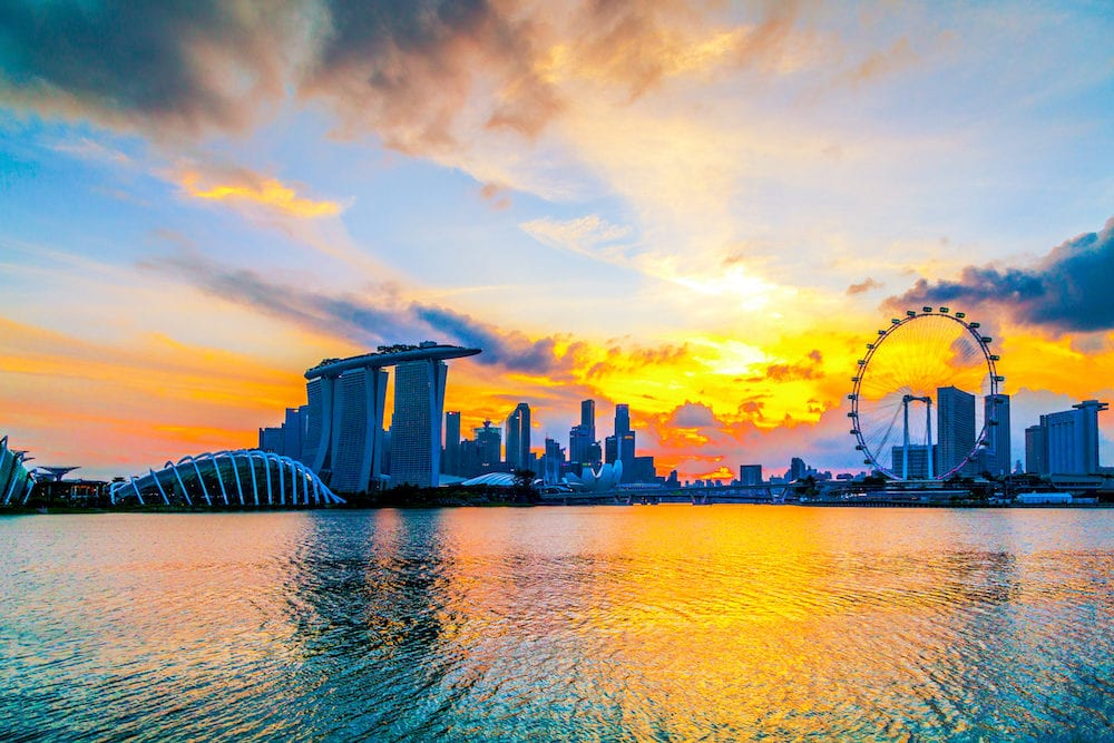 SINGAPORE CITY, SINGAPORE: Singapore Skyline. Singapore`s business district, marina bay sand and the garden by the bay on sunrise