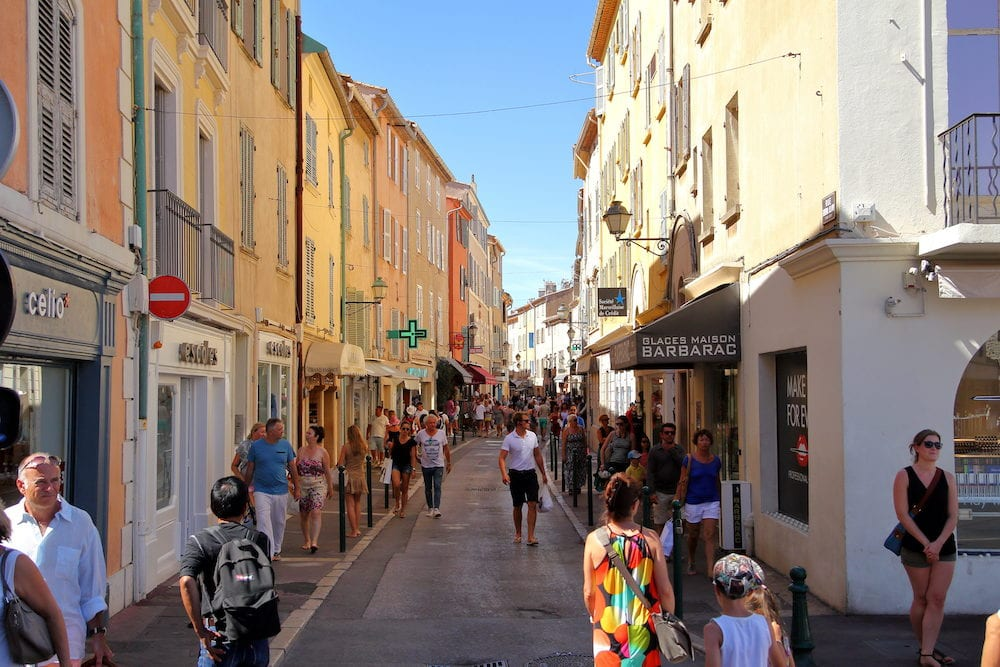 St Tropez Provence France -: Tourists enjoy browsing the shops on the rue General Allard in this famous provencal village