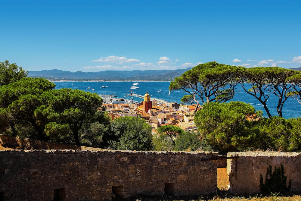 Aerial view of St Tropez old town clock tower and harbor from the citadel hill