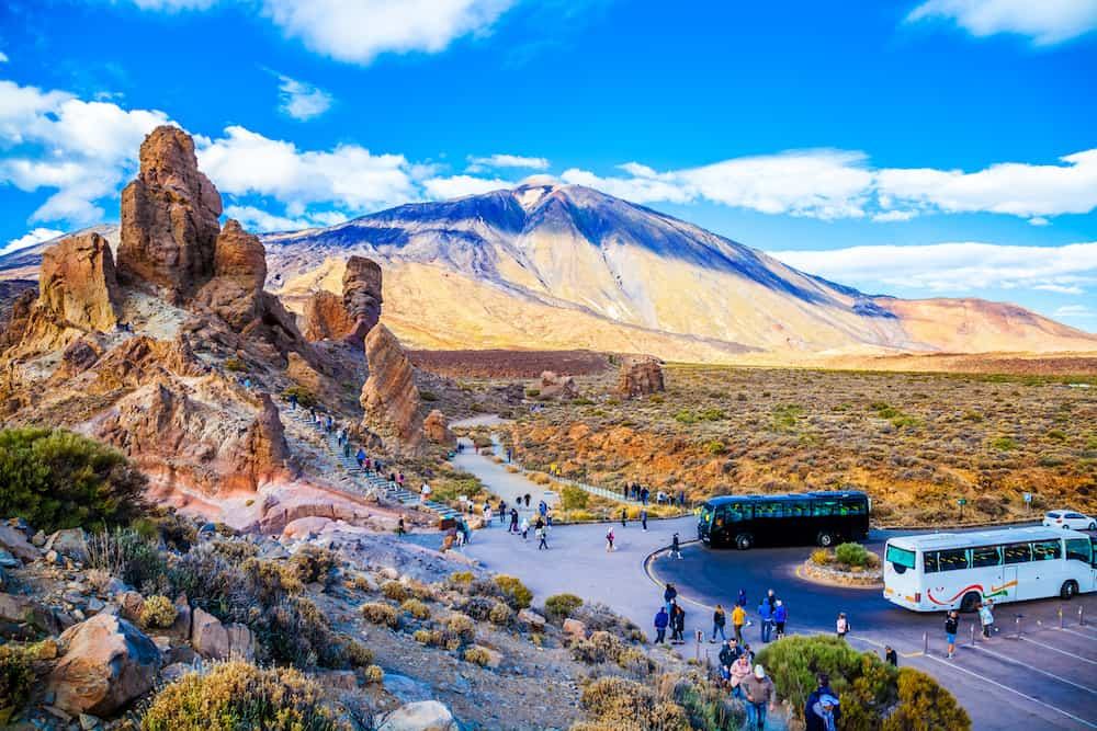 Tenerife Spain - Aerial view over the famous Teide mountain and Garcia stone being visited by tourists from around the world in summer holiday