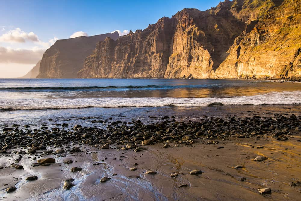 Amazing view from beach in Los Gigantes with high cliffs on the sunset. Location: Los Gigantes, Tenerife, Canary Islands. Artistic picture. Beauty world.