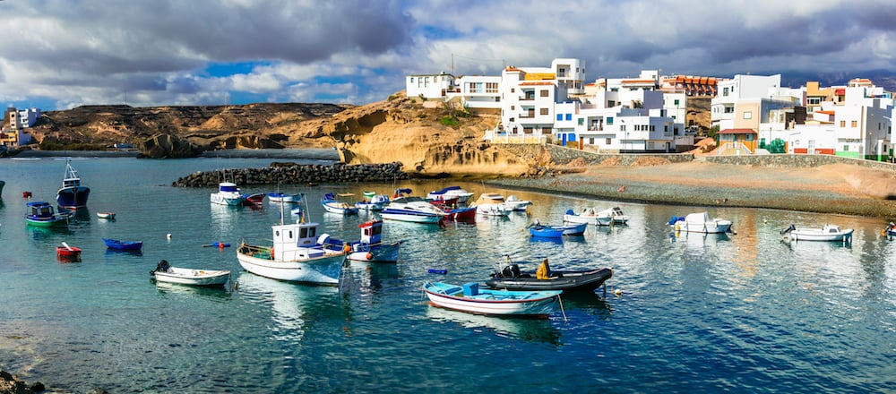 Traditional fishing village in Tenerife island - picturesque San Miguel de Tajao with colorful boats and white houses