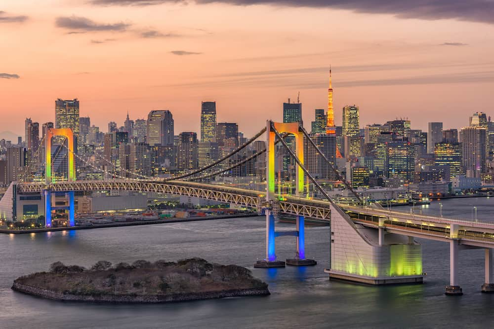 Tokyo, Japan skyline at Rainbow Bridge and Tokyo Bay.