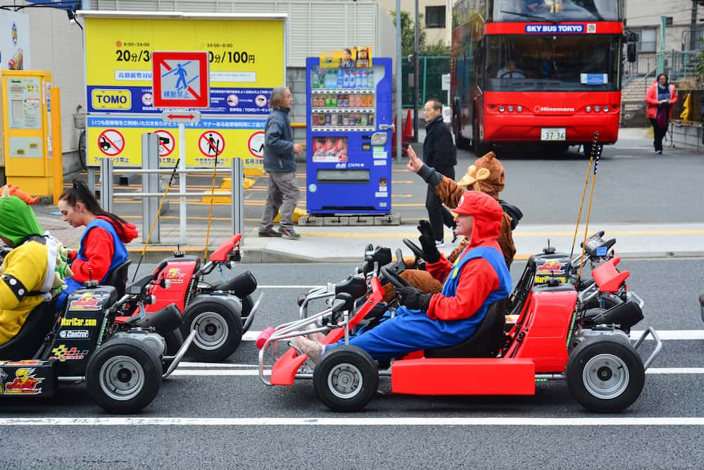 Tokyo, Japan - Street kart tour, Mario kart tour is tourists dress up in superhero character costume and driving go-kart through the main travel attractions in the city of Tokyo