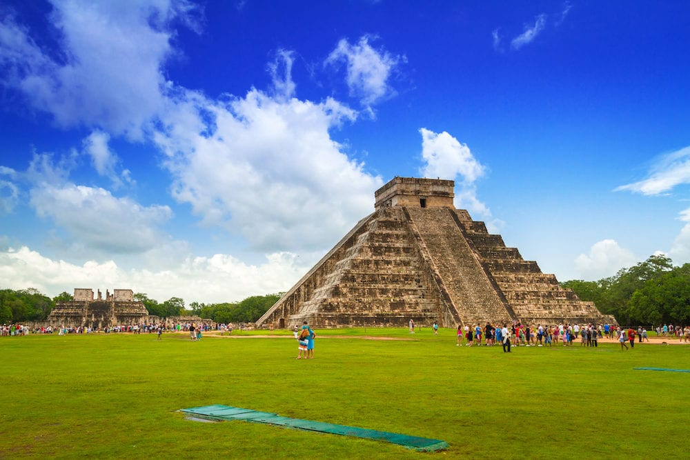 CHICHEN ITZA, MEXICO - Tourists visiting Kukulkan pyramid in Chichen Itza, Yucatan. Kukulkan pyramid is one of seven New World Wonders and popular tourist destination in Mexico.