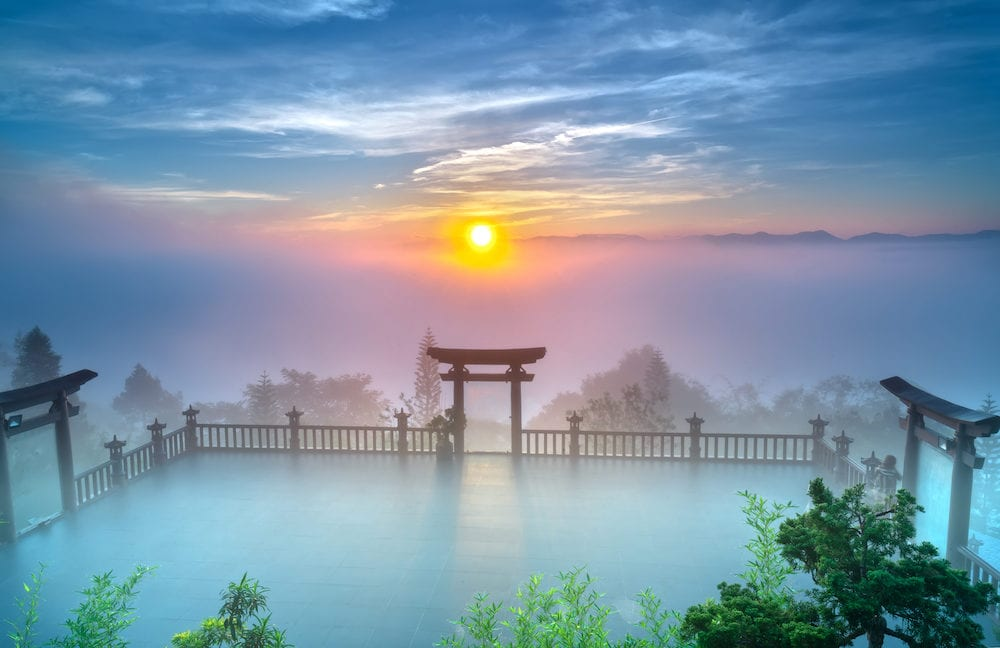 Bao Loc, Vietnam - : The magical dawn on the pagoda, surrounded by dew and magical light from the beautiful sun to meditate and relax the soul in Bao Loc, Vietnam