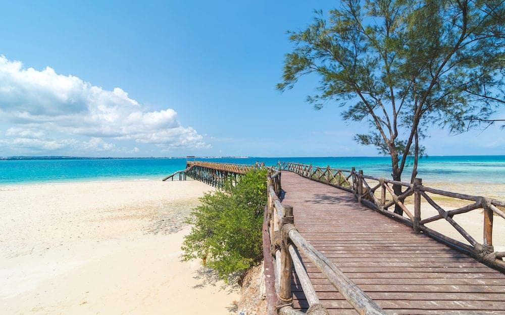 Zanzibar - Wooden pier at Prison island near Zanzibar, Beautiful turquoise water and white sand near Zanzibar, Tanzania