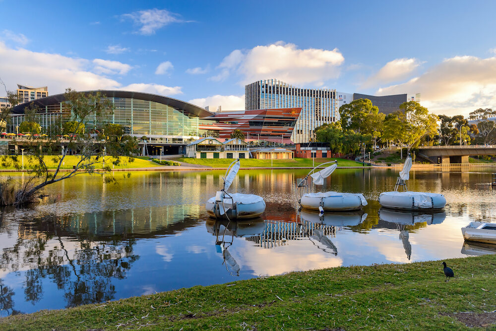 Adelaide, Australia - Adelaide Convention Centre and Riverbank in city centre viewed across Torrens river at sunset