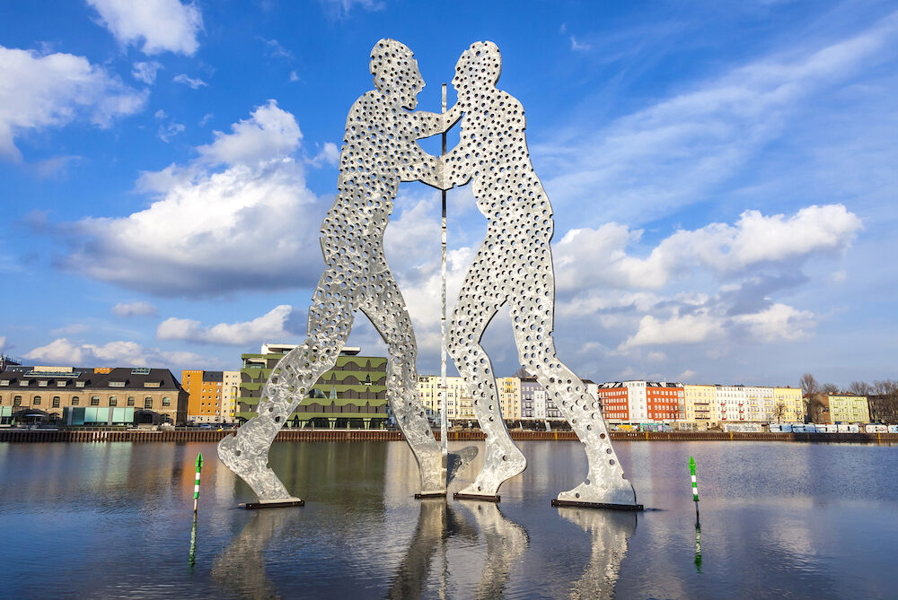 BERLIN, GERMANY - Molecule Man sculpture on Spree River in Berlin. Designed by Jonathan Borofsky, dedicated to the unity of three districts: Friedrichshain, Kreuzberg and Treptow