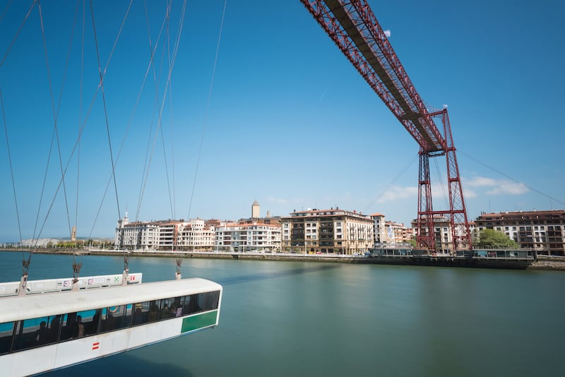 Daylight long exposure of Vizcaya hanging bridge and Nervion river in Portugalete Bilbao Spain.