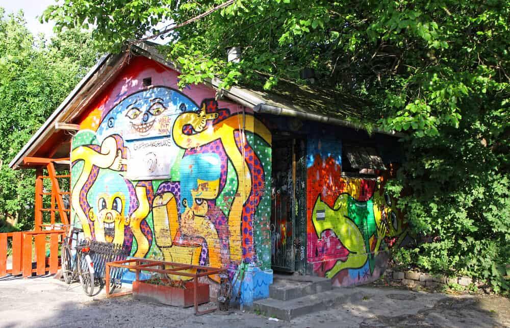 COPENHAGEN DENMARK - Graffiti in Christiania (Freetown Christiania) self-proclaimed autonomous neighbourhood covering 34 hectares in the borough of Christianshavn in Copenhagen