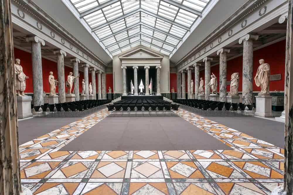 COPENHAGEN, DENMARK : Huge hall of Carlsberg Glyptotek with ancient Roman sculptures of historical museum on 7 September, 2018. Glyptotek has collections with 10,000 works of art.