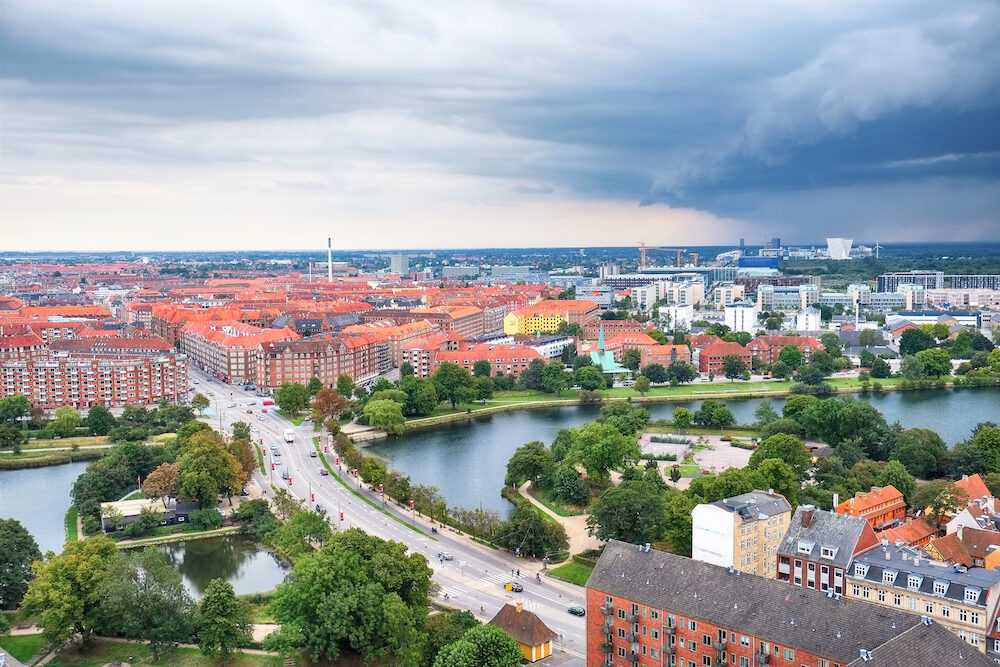 The bird's eye view from the Church of Our Saviour on the Knippelsbro (English: Knippel Bridge) bridge across the Inner Harbour of Copenhagen Denmark. There is the panoramic view of the storm front over Copenhagen.