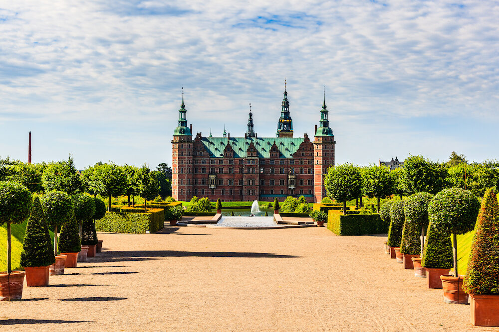 The majestic castle Frederiksborg Castle seen from the beautiful park area