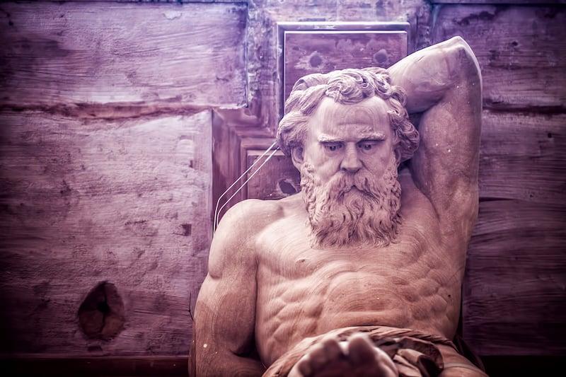 Greek God Statue on a Brick Building in Frankfurt