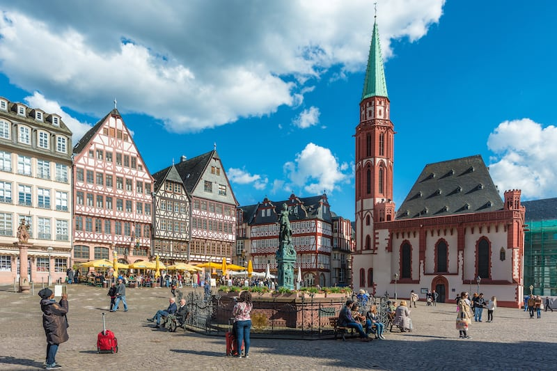 Frankfurt Germany - : Tourist at old traditional buildings in Frankfurt Germany in a summer day. Romerberg town square in Frankfurt Germany