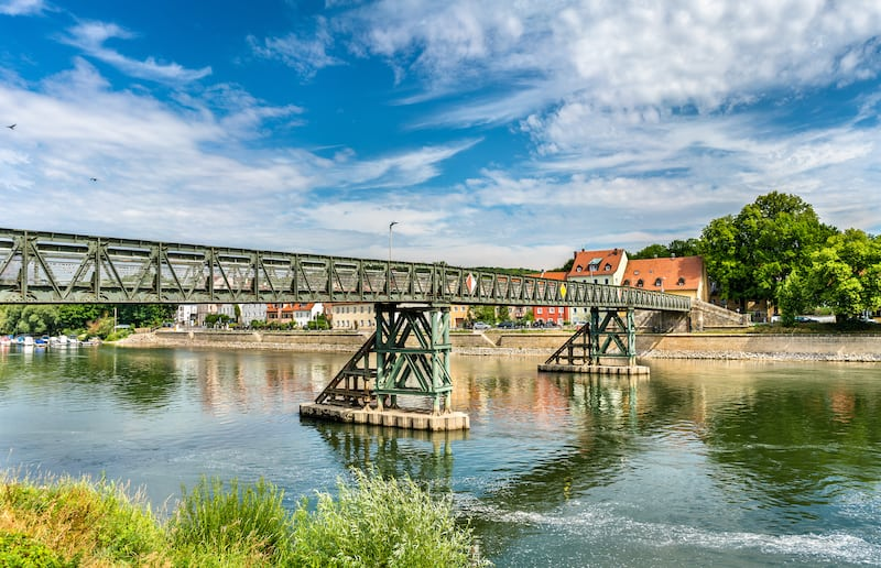 Eiserner Steg bridge across the Danube River in Regensburg - Bavaria, Germany