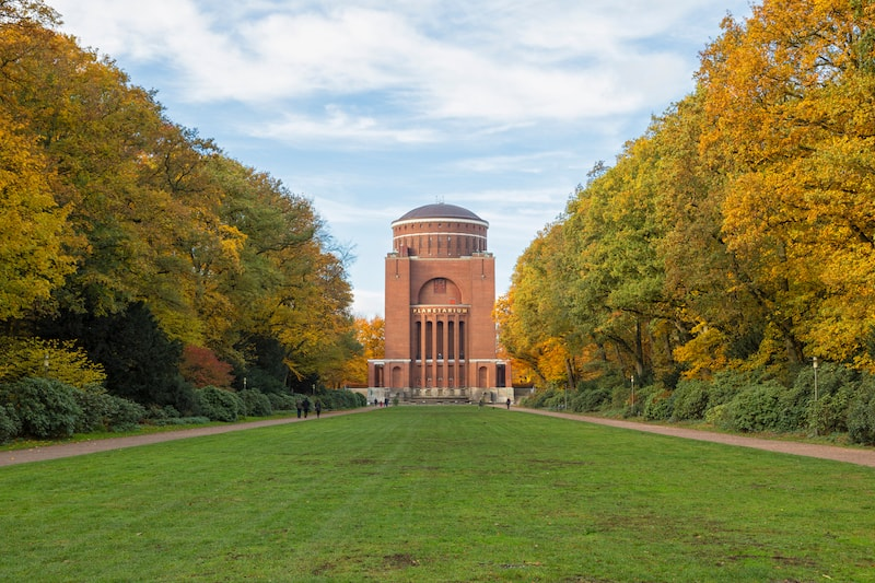 Hamburg, Germany - The Planetarium, a former water reservoir tower, at Stadtpark public park in autumn.