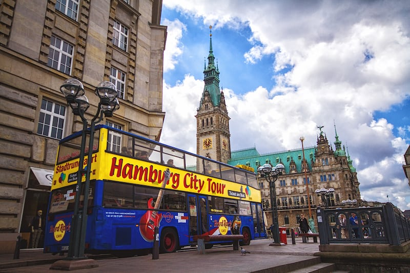 HAMBURG GERMANY - : Exterior view of the town hall of Hamburg and touristic bus in 2012. The town hall German The Hamburg Rathaus was built 1897 and is the seat of the government of Hamburg