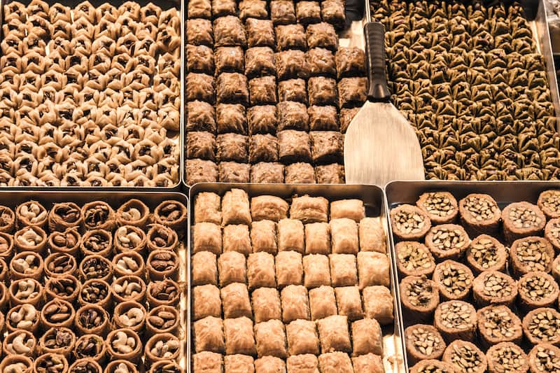 Turkish Baklava, filled with nuts, walnuts, pistaccios and almonds for sale on a market in the city center of Istanbul. It is one of the symbols of Turkey gastronomy and oriental pastries