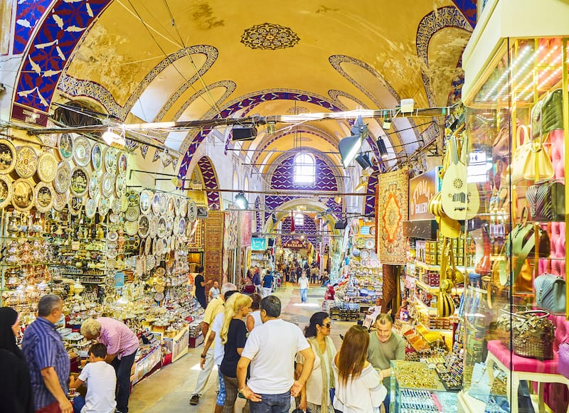 Istanbul, Turkey - Tourists at the passageways of the Kapali Carsi, The Grand Bazaar of Istanbul, Turkey.