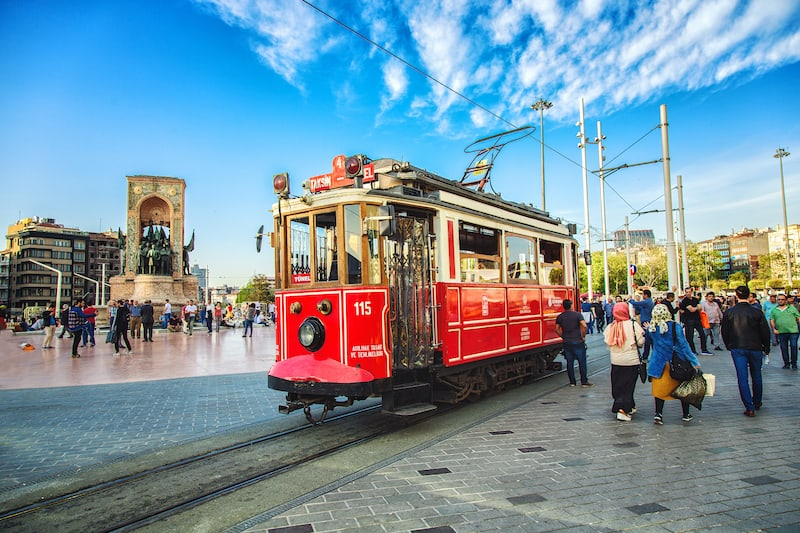 ISTANBUL, TURKEY: Old-fashioned red tram at Taksim square - the most popular destination in Istanbul. Nostalgic tram is the heritage tramway system,