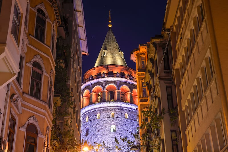 View of the Galata Tower in the historic district in Istanbul at night