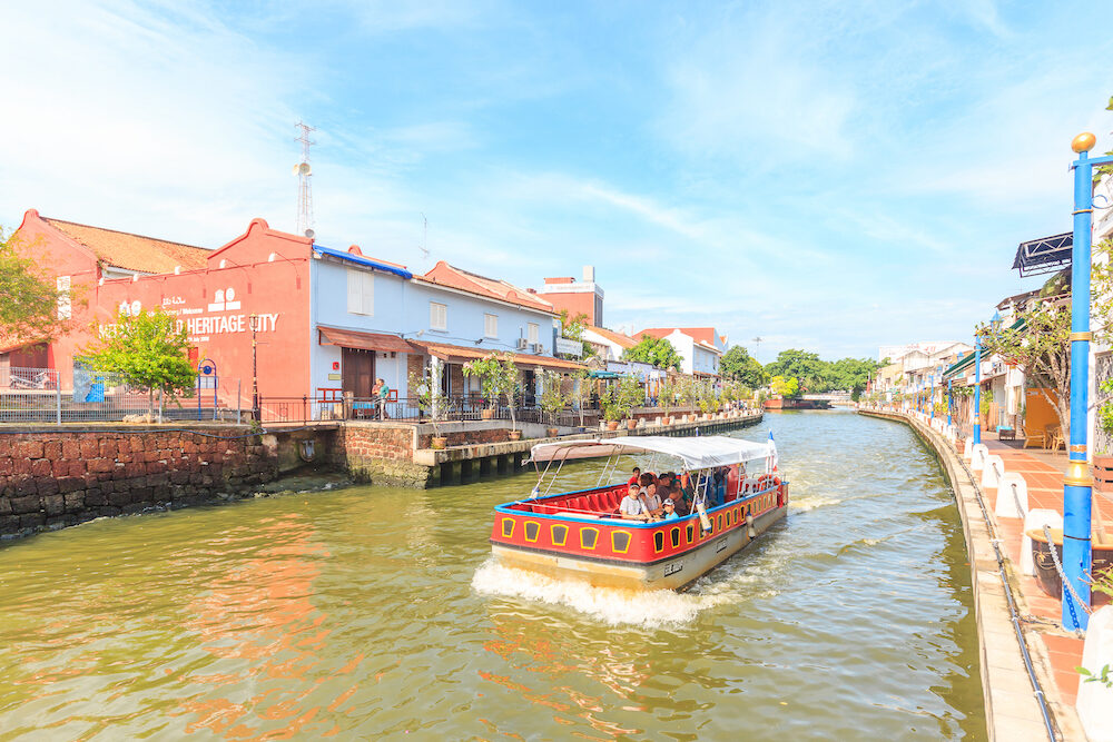 MALACCA, MALAYSIA - Cruise tour boat sails on the Malacca River in Malacca. Rehabilitation of the Malacca River to develop river tourism started in July 2002