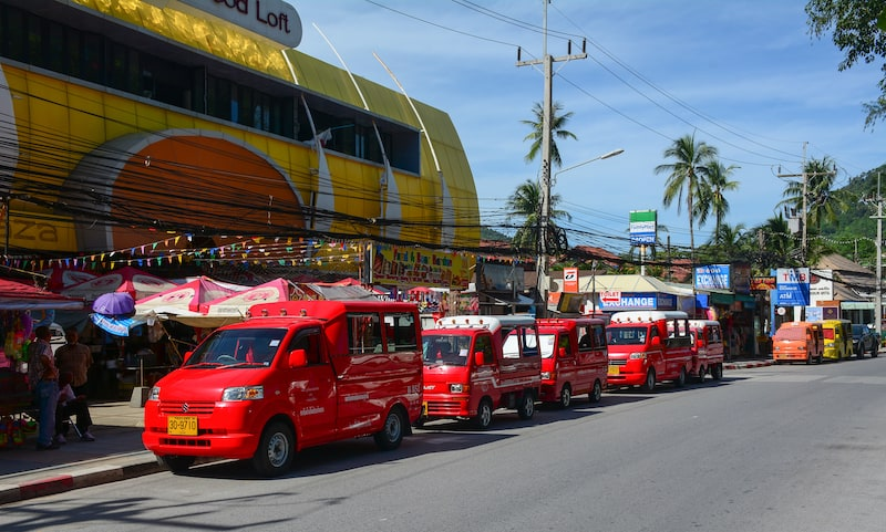 Phuket Thailand - Many taxis (tuk tuk) parking on street in Phuket Thailand. The island is Thailands largest at 48km in length and 21km at its widest.