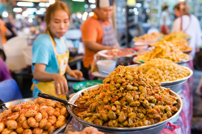 PHUKET THAILAND -Thai food stall with spice fruits on weekend night market in Phuket town.